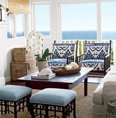 Quadrille Kazak chairs with China Seas Java Java ottomans. Image courtesy of Coastal Living.