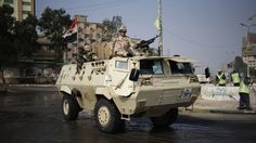 Egyptian Army soldiers stand guard outside the Rabaah al-Adawiya ...