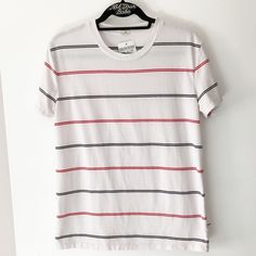 "BNWT striped Nikola top 27"" in length  Color: white, red and navy stripes  A tiny hole on collar, light dust and drink stains on the front and shoulder but easy to wash off Brandy Melville Tops Tees - Short Sleeve"