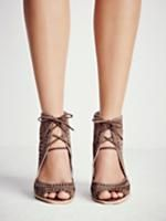 Serena Wedge   Laser cut leather wedges featuring an open toe, adjustable lace-up detailing and a stacked wedge. Padded footbed for extra comfort. Rubber sole.