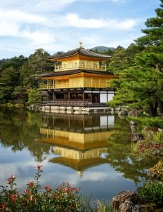 "Tiigra posted a photo:  Kinkaku-ji, literally ""Temple of the Golden Pavilion"", officially named Rokuon-ji, literally ""Deer Garden Temple"", is a Zen Buddhist temple, 1397. Actually, it was rebilt twice after two fires: in around 1470 during a war and in 1950. It was arson. Early in the morning of July 2, 1950 a 21 year old student from Otani University, who also happened to be a monk, set fire to the pavilion. It was reduced to ashes and upon his arrest the young man stated his wish was to…"