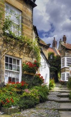 Charming village homes in Robin Hood's Bay in North Yorkshire built in a fissure between two steep cliffs. The village houses were built mostly of sandstone with red-tiled roofs.The town, which consists of a maze of tiny streets, has a tradition of smuggling, and there is reputed to be a network of subterranean passageways linking the houses. During the late 18th century smuggling was rife on the Yorkshire coast.