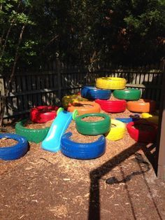 Well, it wasn't easy with a 3 year old around. But free tires from garages more then willing to give them away. A few cans of spray paint from Walmart (paint after assembled to save on paint) and Cypress mulch (packs really nicely) from Home Depot. Adding in a Little Tikes sliding board that he is out growing and you have a home made fun, play area for a very active little boy!!