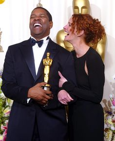Julia got a laugh out of Denzel Washington after he won an Oscar for Best Actor at the 2002 Academy Awards.