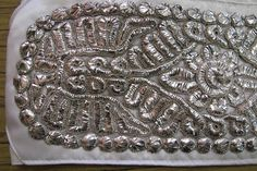 India - Silver plate embroidery.