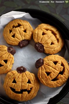 Jack-o'-Lantern Cookies (from diamonds for dessert blog)  2 1/2 cups flour  1 tsp baking soda  1 tsp baking powder  1 tsp cinnamon  1/2 tsp nutmeg  1/2 tsp salt  1 1/2 cups sugar  1 stick butter, soft at room temp  1 cup canned pumpkin  1 egg  1 tsp vanilla extract  semisweet chocolate