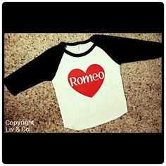 Handmade, boys 'Romeo' Valentine's Day t shirt by Liv & Co. is a must have for your little manswardrobe for anytime of year. Your super soft shirt will comeon an adorable, unisex,black, 50/50 cotton/poly,raglan sleeved baby& toddler baseball tee (as pictured)! Be the best gift - giver at the baby shower with this adorable little one piece or shirt! These shirts are an American Apparel brand, design by Liv & Co.making these 100% MADE IN THE USA!There isn't a better baby shower gift…
