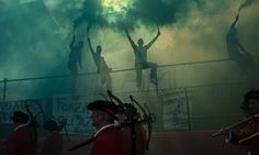 Supporters of the Santa Croce Azzuri team cheer on their players before the final match of the Calcio Storico. The Calcio Storico – 'historic football' – is an ancient form of football from the 16th century, which originated from the ancient roman 'harpastum', and is played in teams of 27, using both feet and hands. Kicks to the head are prohibited but headbutting, punching, elbowing, and choking are all allowed
