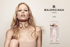 Face of Balenciaga's first fragrance under Alexander Wang, Anna Ewers, fronts a new campaign for the B. Balenciaga Skin scent. In the image, Anna wears a bold cat eye, nude-colored top and rose gold choker to go with the perfume bottle's rose gold coloring. ICYMI: See Anna Ewers Best Moments with Alexander Wang Enjoyed this …