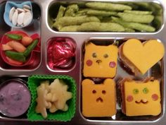 Apple bear slices, carrots and pea pods, peapod crackers,  pumpkin seeds,  blueberry yogurt,  PB with cheese overlay bear, heart, and pokemon, and chocolate heart