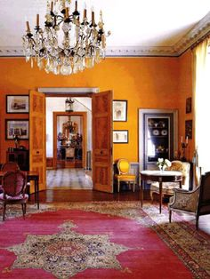 Colourful opulent home. Like the mustard walls and persian rug.