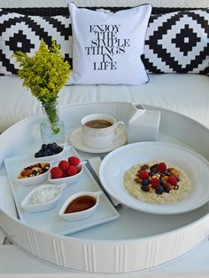 Turn a small terrace into a breakfast nook and create a luxurious space to start each morning with all white accessories and dinnerware from HomeGoods.