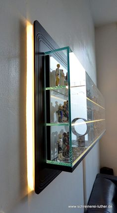 German furniture makerSchreinerei Luthermade this elegant shelffor a customer who wanted to display their collection of Kenner Star Wars action figures. The shelf measures about 6ft. x 2ft. and is made of MDF and glass.                                                                                                                                                      More