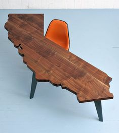 Fantastic California Desk... would look great if you have an overhead second floor so you can see the shape. How you put things on it for storage and organization I will never know. But who cares, this is cool! From Etsy $3000.00