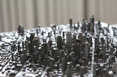 Among his contemporary works on display, Type City is Jang's sprawling seaport metalopolis of tall lead type buildings and boulevards bisecting the city into a topographic and typographic landscape. With the patience of a skilled hand typesetter, he set the tall buildings of metal type upright so they are capped with individual letters.