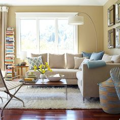 neutral sectional + tall stack of books