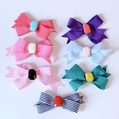 B E S T - S E L L E R A colorful assortment of pretty hair bows is every little girl's staple accessory. These LARGE bows feature a fun gemstone center, making this a fun accessory to dress up in, or