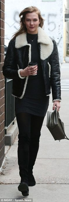 Busy day: The model left her long hair down and carried a stylish dark leather handbag...