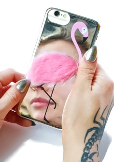 Skinnydip Flamingo Fluff iPhone Case is gunna act as yer mating call, bb~ This dope iPhone case features a sturdy mirrored base, flamingo graphics, and a fluffy pink patch.