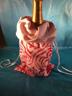 A personal favorite from my Etsy shop https://www.etsy.com/listing/385538896/wine-bag-magenta-swirlwhite