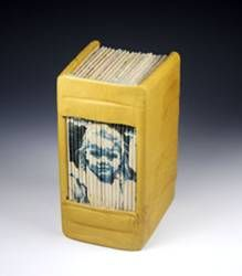"""""""Girl in the World"""" by Roberta Lavadour. 4.75 (h) x 3 (w) x 2.25 (d). Vintage atlas pages sewn on tapes with each gathering wrapped with a duotone silk screen image to form a complete image on the spine and allow the images to be viewed inside throughout the book. Covered with reclaimed leather that's been scrunched to form a rustic and satisfying feel. Use it as a journal and write over the maps or just display it as is."""