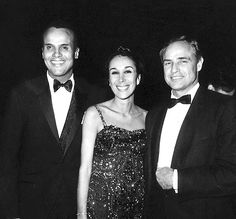Marlon Brando photographed with Harry Belafonte, Julie Belafonte (who was once his girlfriend)