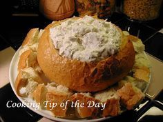 Corned Beef Bread Dip:  All you need:  ¾ cup mayonnaise ¾ cup sour cream Thinly sliced deli Buddig Corned Beef,  Green onion (as much as you'd like) Swiss cheese grated 2 loaves of bread, one round  Combine all ingredients EXCEPT bread in large bowl. Blend well. Refrigerate overnight. Great served cold or warmed.