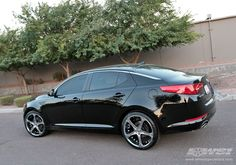 "Another customized ride.  Believe it or not, this is a 2011 Kia Optima.  If I could afford the wheels (probably very expensive) I would buy it tomorrow.  ""Sey-la-veh"" to my Honda Accord!!"