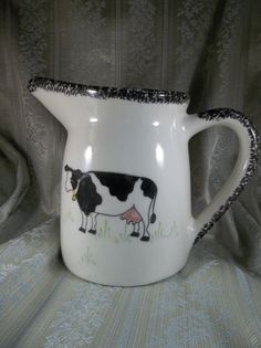 N. S. Gustin Co. Hand Decorated Black and White Cow Kitchen Pitcher