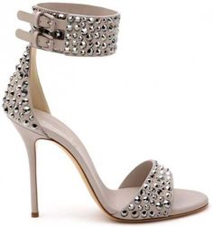 Love the ankle strap and stud detail on this sandal
