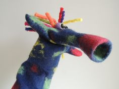a one-of-a-kind hand felted hand puppet, this funky dude will liven up any play-time. his multicoloured rasta hair and honky nose make him unique and unusual, as well as fun and fabulous! Rasta Hair, Hand Puppets, Dinosaur Stuffed Animal, Hands, How To Make, Heaven, Puppet, Sky, Heavens