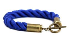 Bullet Shell & Rope Bracelet Rope is secured in two 9mm bullet shells with a toggle clasp.