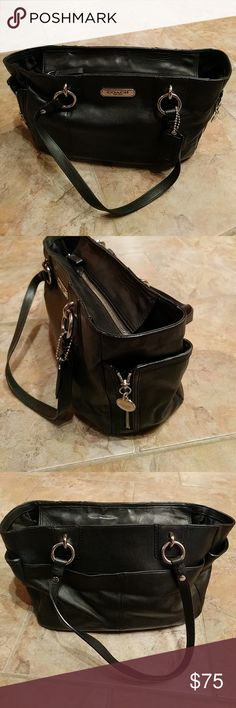 Coach Handbag Beautiful black leather Coach handbag with black satin interior.  Large zip pocket inside and 2 slide in pockets.  Large pocket on back side of bag and 2 expandable pockets on each end.  Like new condition. Coach Bags Shoulder Bags