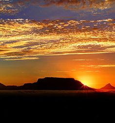 Photographer Albertus Ziervogel - The clouds, the warm light of sunset on Table Mountain