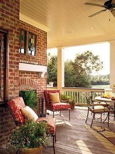 Love the outdoor built in Fireplace on the wrap around porch.