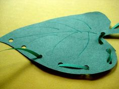 The Very Hungry Caterpillar activities     hole-punched, threaded leaf