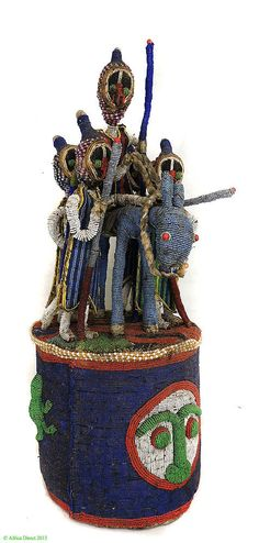 Africa | Beaded crown topped with King on horse and 4 Guardians from the Yoruba people of Nigeria | Glass beads, cotton cloth, vegetal fiber | 2nd half of the 20th century