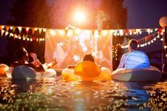 Looking for a cool twist for an birthday or college gathering? Host a movie night in your backyard or pool and watch campy flicks and popcorn.: A Movie Night Party for Teens Pool Movie, Dive In Movie, Backyard Movie Party, Backyard Pool Parties, Backyard Movie Nights, Outdoor Movie Nights, Backyard Bbq, Backyard Ideas, Pool Fun