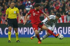 Alvaro Morata of Juventus and Xabi Alonso of Bayern Muenchen compete for the ball during the UEFA Champions League round of 16, second Leg match between FC Bayern Muenchen and Juventus at the Allianz Arena on March 16, 2016 in Munich, Germany. (March 15, 2016 - Source: Alexander Hassenstein/Bongarts)