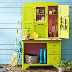 armoire repurposed as potting storage bench