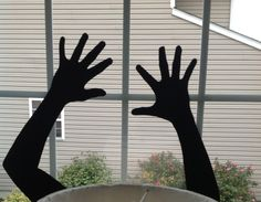 DIY HALLOWEEN WINDOW SILHOUETTES - do this and you can create an entire DIY Haunted House (in this picture I used my son as a hand model).  -by Snazzy Little Things