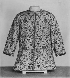 This early 17th century woman's jacket is made of silk, a more luxurious fabric than the linen typically used for such garments. However it is made in a loose, informal style not seen in portraiture. The lining of shag (silk velvet with a long pile) suggests the garment was intended for warmth as well as adornment. It is richly embroidered in silver and silver-gilt thread, purl, strip and spangles. The design of rose, marigold, honeysuckle, pansy and lily flowers in a symmetrical interlacing of