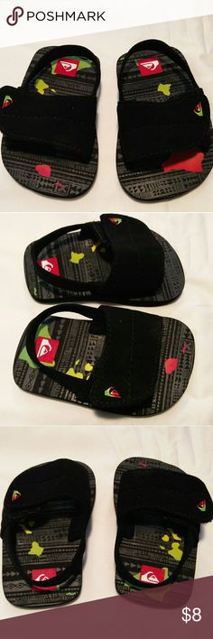 """Quicksilver black Hawaiian baby sandals Quicksilver baby sandals with red yellow and green Hawaiian islands. Never worn. Purchased in Hawaii. Perfect for your little surfer dude or surfer girl! The size isn't listed, but they're 4.25"""" long so size 2 is a rough guess. Please measure your baby's foot to gauge fit. Quicksilver Shoes Sandals & Flip Flops"""