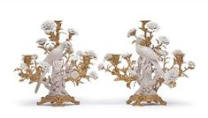 A pair of candlesticks with 'bronze doré' mounts and birds sitting on branches,