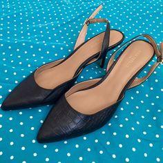 ANN TAYLOR BLACK HEELS Barely worn black sling back strap heels by Ann Taylor.. Size 9 1/2 M Ann Taylor Shoes Heels