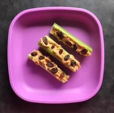 Serving size: 1 large celery stalk cut into 3 pieces, 1 tablespoon natural peanut butter, 15 raisins Calories: 130 Protein: 4 gramsFat: 8 gramsFiber: 2.5 gramsCarbs: 11 gramsSugar: 6 grams