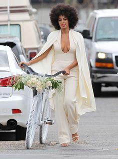 Solange opted for a low-cut cream colored pantsuit with a cape and plunging neckline by Stephane Rolland.
