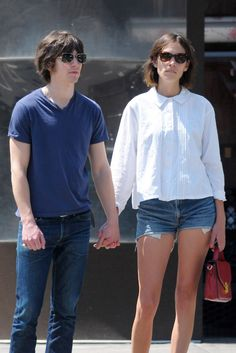 earlysunsetsovermonroeville:    Alexa Chung & Alex Turner walking in the East Village - May 25, 2011
