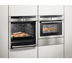 The oven door slides out of the way! Saw this on The Great British Baking Show on PBS and now I want one: NEFF B46E74N3GB Slide & Hide Electric Oven.