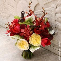 Tropical Wedding Bouquet Arranged With: Ivory David Austin English Garden Roses, Elegant White/Green Lady Slipper Orchids, Chocolate Brown Fern Shoots, Red Roses, Ranunculus, Red Double Tulips, Red Calla Lilies, & Red Mokara Orchids~~